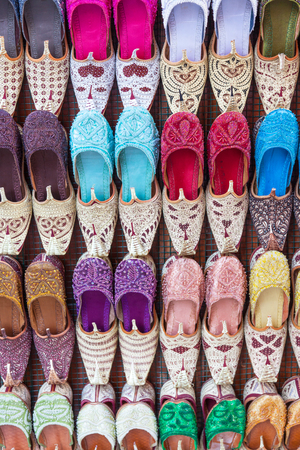 Arabian shoes on sale in a traditional souk in old Dubai, UAE. Stock Photo