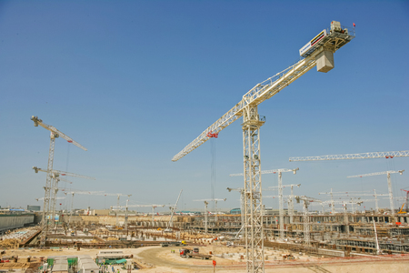 DUBAI, UAE - FEBRUARY 8, 2005: An expanse of cranes during the building boom in Dubai early this century.