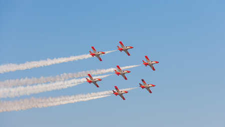 DUBAI, UAE - NOVEMBER 11, 2007: The Spanish Air Force Aerobatic Team, Patrulla Aguila (Eagle Patrol), flying over Dubai. Flying seven Casa C-101 Aviojets, the team is known for its formation landings. Editorial
