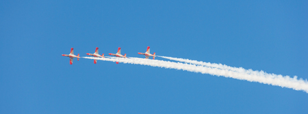 DUBAI, UAE - NOVEMBER 11, 2007: The Spanish Air Force Aerobatic Team, Patrulla Aguila (Eagle Patrol), flying over Dubai in the UAE. Flying seven Casa C-101 Aviojets, the team is known for its formation landings.