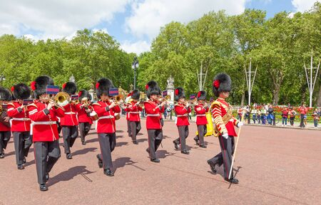LONDON, UNITED KINGDOM – JULY 11, 2012: The band of the Coldstream Guards marches down The Mall at the completion of the Changing of the Guard ceremony. Editorial