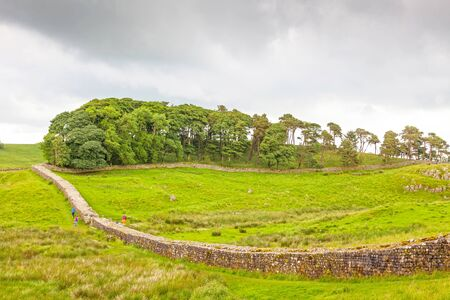 NORTHUMBERLAND, ENGLAND - JULY 7, 2012: A section of Hadrian's Wall in Northumberland, England.