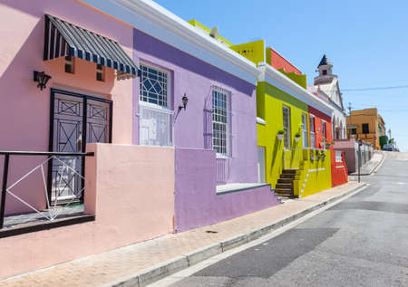 Colourful cottages in a street in Bo Kaap, formerly known as the Malay Quarter, in Cape Town, South Africa. Stok Fotoğraf