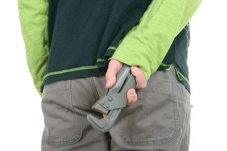 Teenager hides  trumpet key on  white background photo