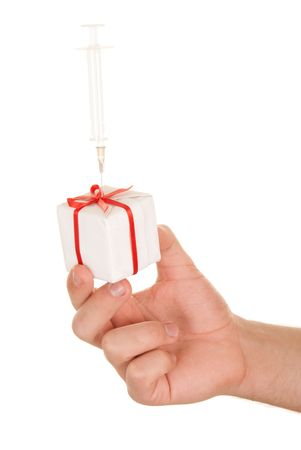 are thrust: Hand holds gift with the thrust syringe on white background