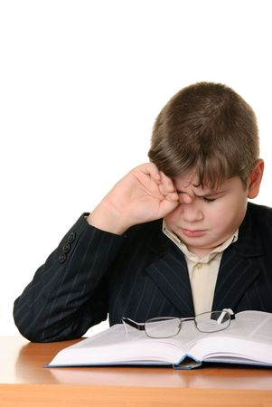 weariness: Boy wearing spectacles masses an eye for weariness is isolated on white Stock Photo