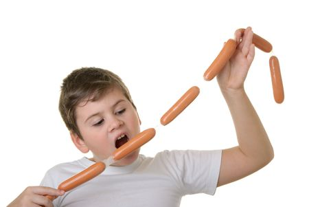 emote: Hungry boy bites sausage isolated in white Stock Photo