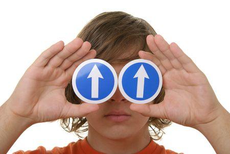 specifying: Teenager holds before arrow eyes specifying upward isolated in white