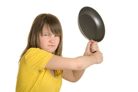 dissatisfaction: Offended girl has threatened frying pan isolated in white Stock Photo