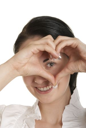 declare: Young woman shows fingers heart symbol isolated in white Stock Photo