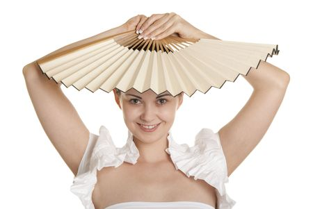 pleasantness: Young woman holds fan over head isolated in white