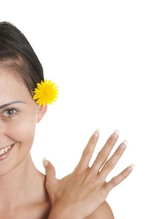 pleasantness: Young woman with yellow flower isolated in white Stock Photo