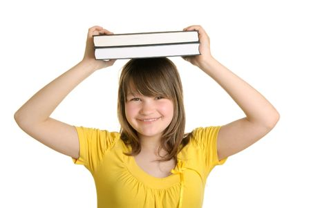 Smiling girl holds books on head isolated in white photo