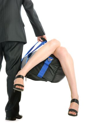 Man holds bag with sticking out female feet isolated in white