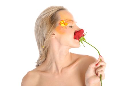 Young woman bites flower isolated in white photo