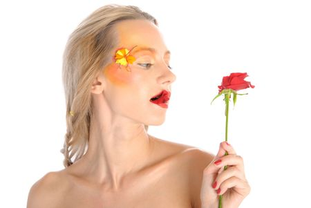 Young woman bites red flower isolated in white photo