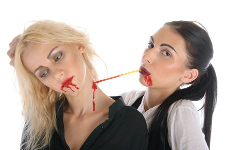 long shot: Woman sucks blood from neck of other woman isolated in white