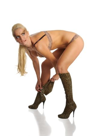 Sexual woman dresses boots isolated in white photo