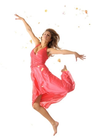 Sexual woman in jump and petal photo