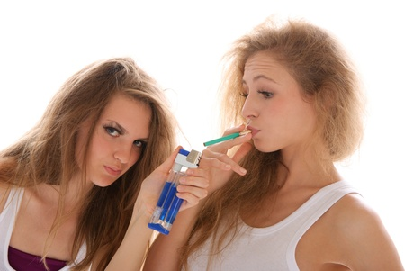 Two young women with cigarettes Stock Photo - 8380487