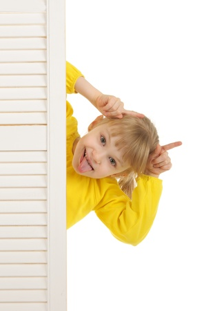 pleasantness: Girl puts out tongue in yellow jacket Stock Photo