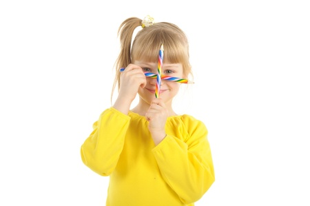 pleasantness: Little girl with colour pencils Stock Photo