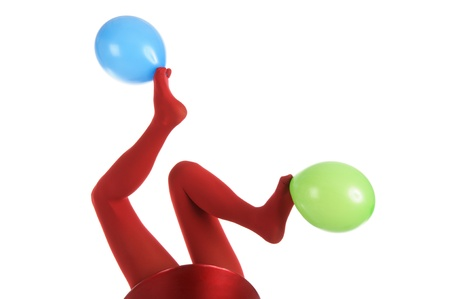 panty hose: Female feet in red stockings with balloons Stock Photo