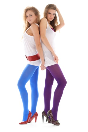emote: Two young woman in colour stockings Stock Photo