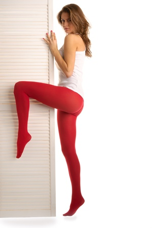 Beautiful woman costs near to door
