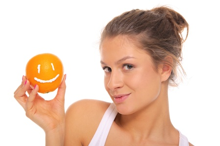 emote: Woman holds orange with smile Stock Photo
