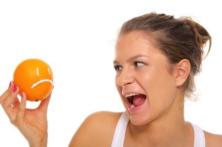 spite: Woman holds orange with insult Stock Photo