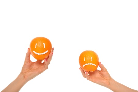 malice: Hands hold oranges with smile and insult