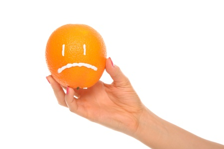 dissatisfaction: Hand holds orange with drawn insult Stock Photo