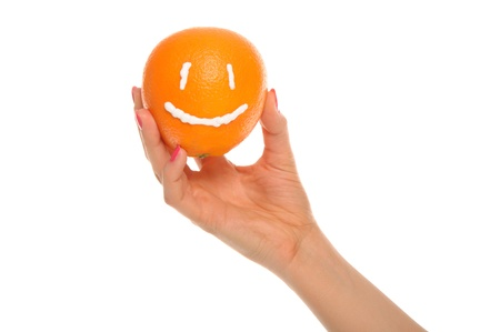 pleasantness: Hand holds orange with drawn smile