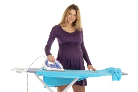 pregnant woman in a purple dress with an iron photo