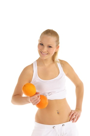 woman engaged in fitness dumbbells of oranges photo