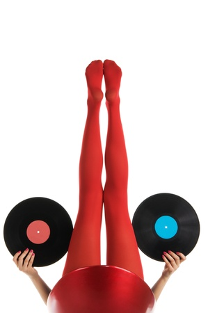 panty hose: Female feet in red stockings with vinyl record