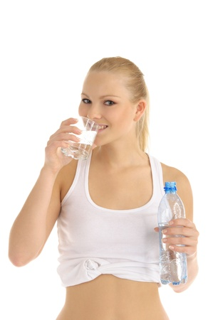 happy woman drinks water from a glass photo