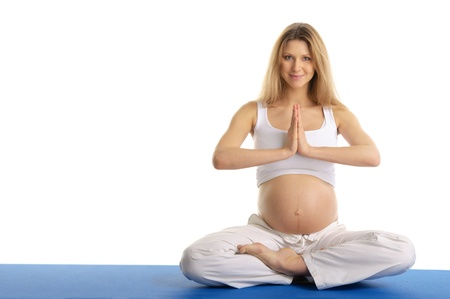 Pregnant woman practicing yoga, sitting photo
