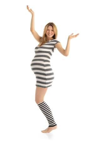 pleasantness: happy pregnant woman in a striped dress