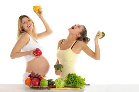 concordance: Two women dance with fruits and vegetables