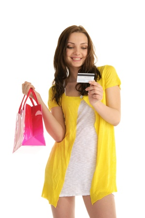 happy woman with credit card and shopping isolated on white Standard-Bild