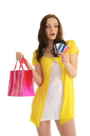 surprised woman with credit cards and shopping isolated on white photo