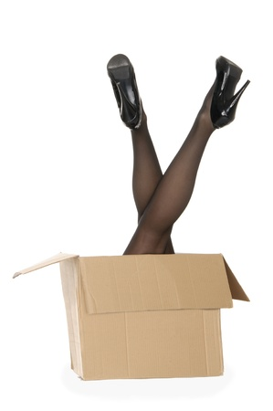 Womens legs sticking out of the box is isolated on a white