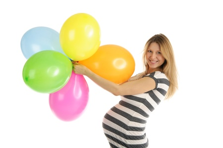 pleasantness: pregnant woman with balloons isolated on white Stock Photo