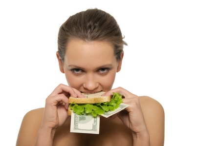 Woman biting a sandwich out of money and lettuce isolated on white Standard-Bild