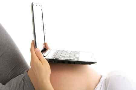 laptop on  stomach pregnant woman