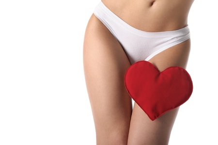 heart at the foot of woman in white lingerie Stock Photo - 9357612