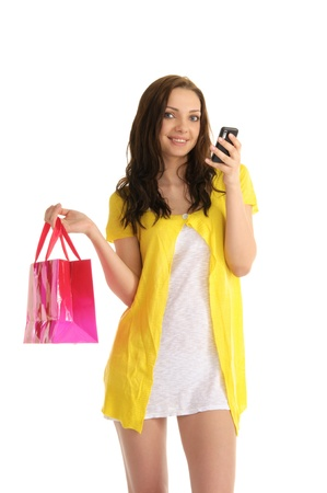 young woman with a phone and bag photo