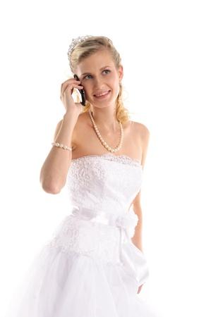 happy bride with mobile phone Stock Photo - 9470543